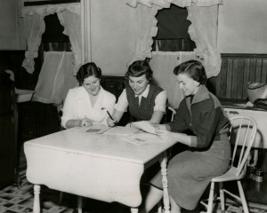 The Rosaverian staff members discuss finances (1955).  From the Saint Rose Archives photo collection