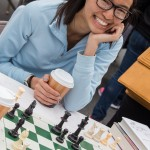 Saint Rose student, Priscilla Ly, is all smiles while playing a game of chess.