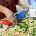 Salad being prepared.