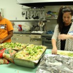 Megan Evans, and Mia Frassrand add the finishing touches to the salad.