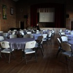 Preparing for guests to arrive at the First Lutheran Church for a community ziti dinner.