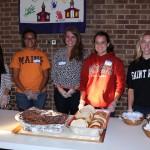 Saint Rose students, Mia Frassrand, Megan Evans, Rachel Demarais, Alycia Little, and Kelly Slingerland are ready to serve dinner.