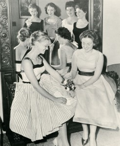 Rosebud's sitting at familiar bench admiring wrist corsage at Senior Ball from 1961 yearbook.