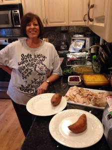 My mom standing over our delicious Thanksgiving Dinner! Photo Credit to Genevieve Diller.