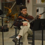 Multi-talented student, Dan Frank, plays holiday songs on his banjo during the Celebration of the Seasons.