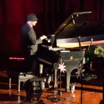 "Peanuts Gallery pianist 'bangs out' Jingle Bells in the style of Schroeder at the annual ""It's A Jazzy Christmas"" concert."