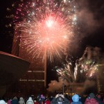 The crowd enjoys fireworks over the plaza after the Holiday Tree is lit.