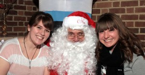 Me and my friend Audra posing with Santa!! I just love Christmas! Photo Taken by Ralph Panelli.
