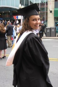 Me, awkwardly posing in graduation attire, in 2011. Also, hood is wrong. It should be folded out.