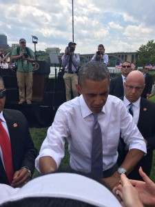 Sliding my card through a handshake to the President. (I'm wearing the white bandanna)