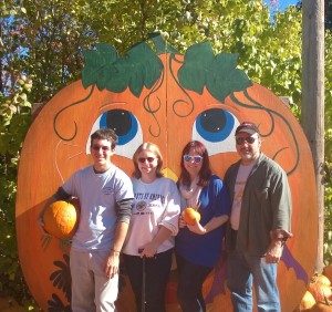 Pumpkin buying at Apple picking with the family