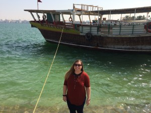 Me in front a Dhow Boat in the Arabic Gulf. Very warm sea water! :) Courtesy of Kelly Hoehn