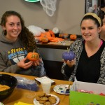 Students showing off their painted pumpkins