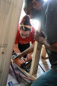 Helping repair a home in New Orleans, LA on an Alternative Spring Break Trip sponsored by the Community Service Office!