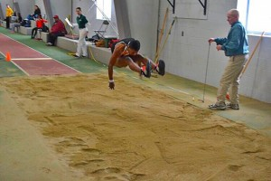 Benson competing in his long jump event