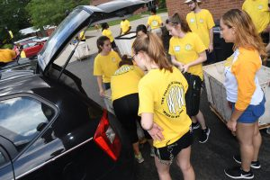 Students unpacking a car at Saint Rose on move-in day in Fall 2017.