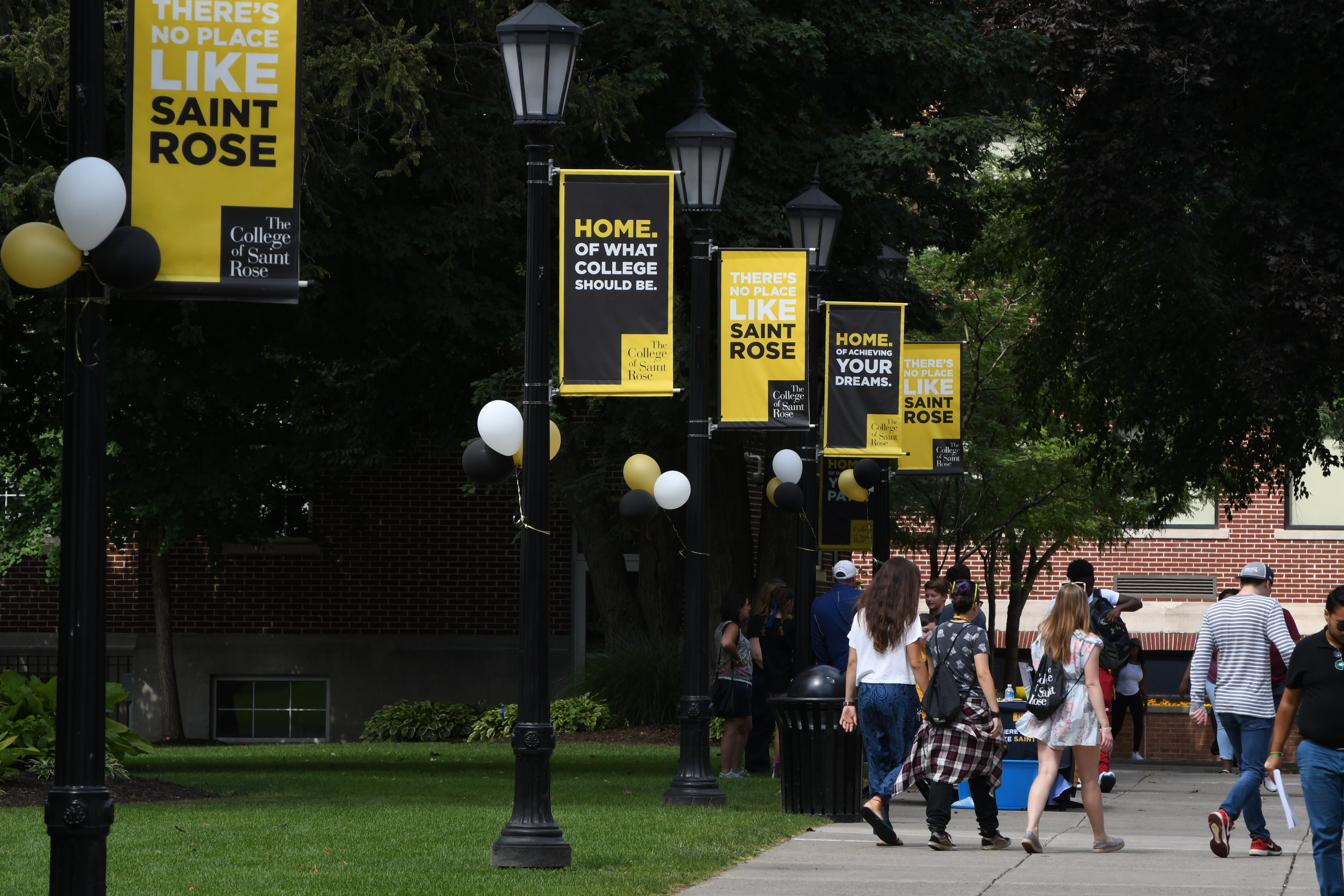 Saint Rose students walking on the sidewalk on move-in day in Fall 2017.