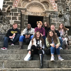 students from chamber choir at saint rose posing in france outside