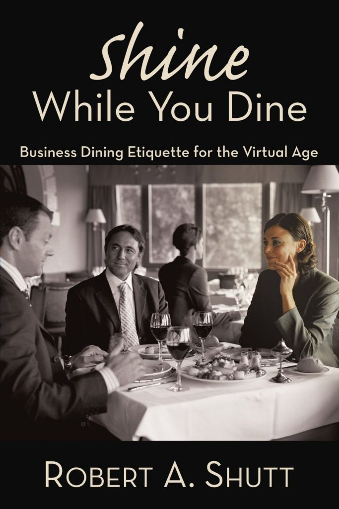 "Book cover for ""Shine While You Dine,"" a business etiquette book."