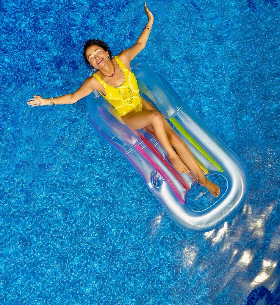 woman on pool float in pool