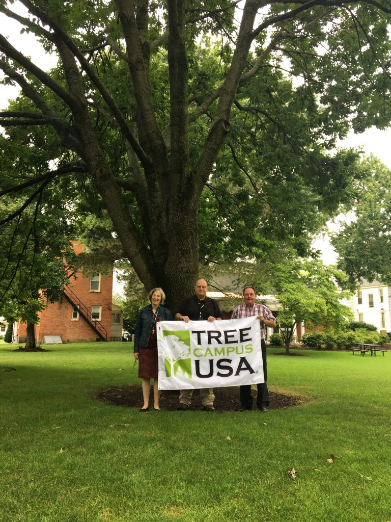 Saint Rose employees with Tree Campus USA sign