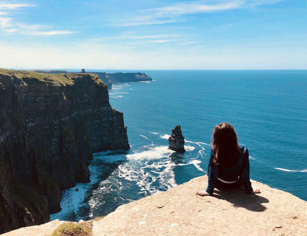 Juliann overlooking The Cliffs of Moher in Ireland