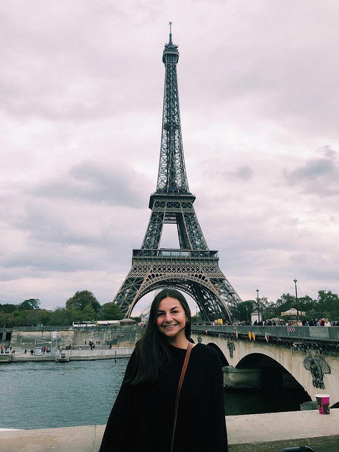 Saint Rose student in front of Eiffel Tower