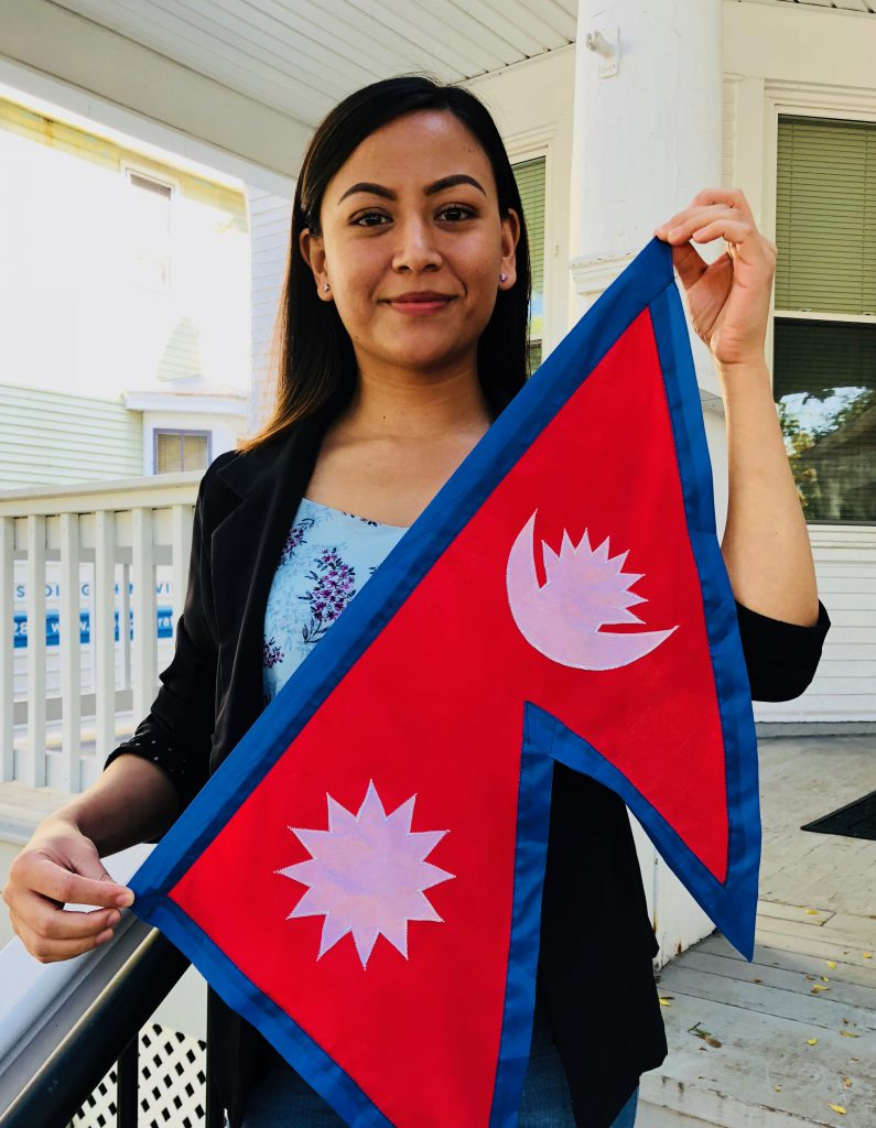 Ridina Shakya G'19 with flag of Nepal
