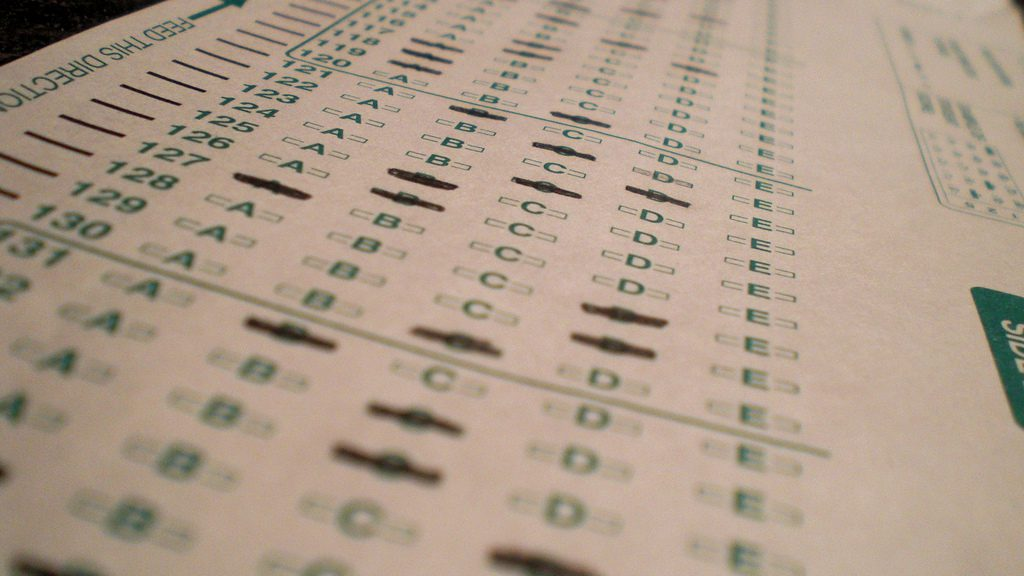 standardized test sheet with multiple choice bubbles to fill in