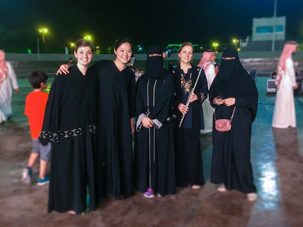 Assistant Professor Suna Gunther standing with several other musicians in Saudi Arabia