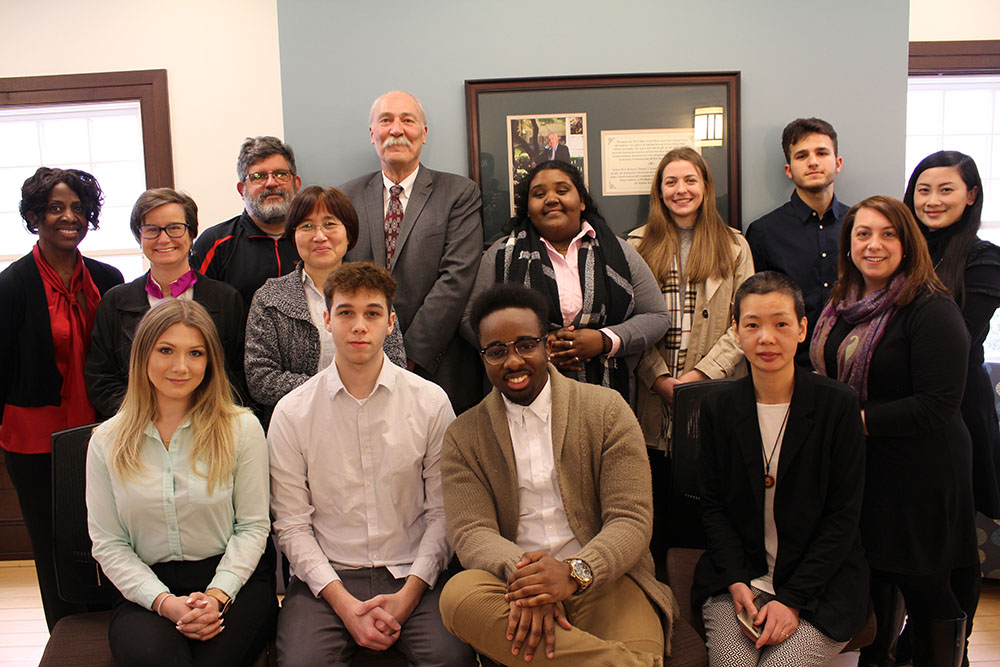 Business students photographed with Dean Michael Matthews