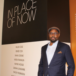 Rone Shavers, saint rose professor, at Afrofuturism exhibit he co-curated