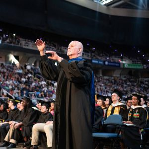 Michael Levi at commencement conducting his final performance