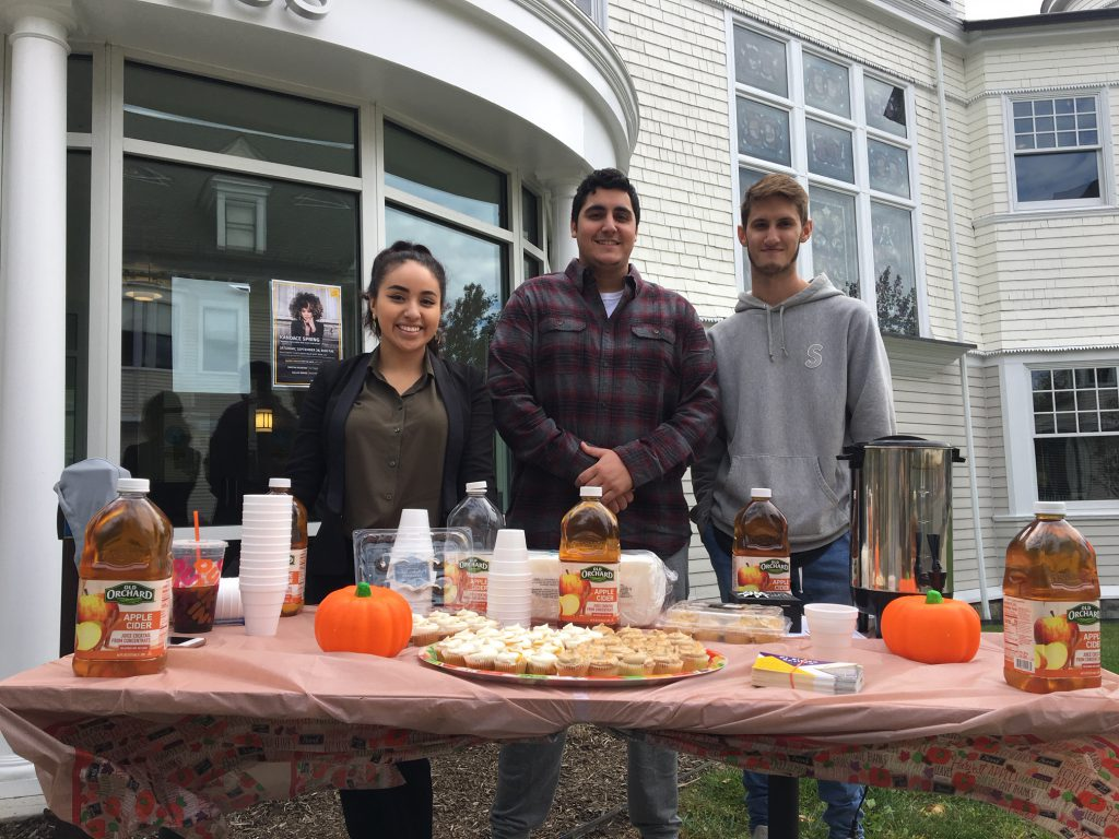 students outside of Huether selling apple cider