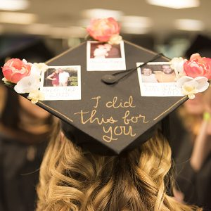 "Student graduation cap that says ""I did this for you"""