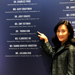 Professor Young Kim in front of the hall of fame