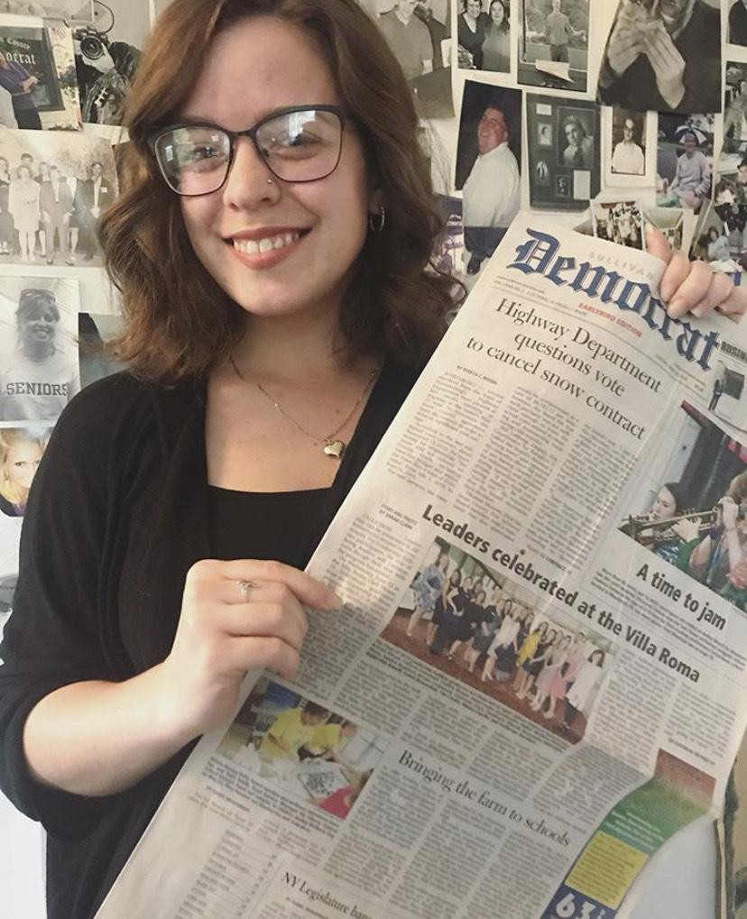 Sarah Clark with newspaper