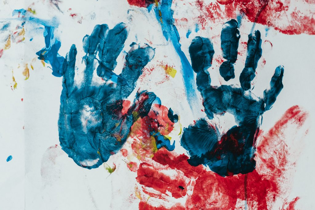 children's colorful ink hand prints on paper