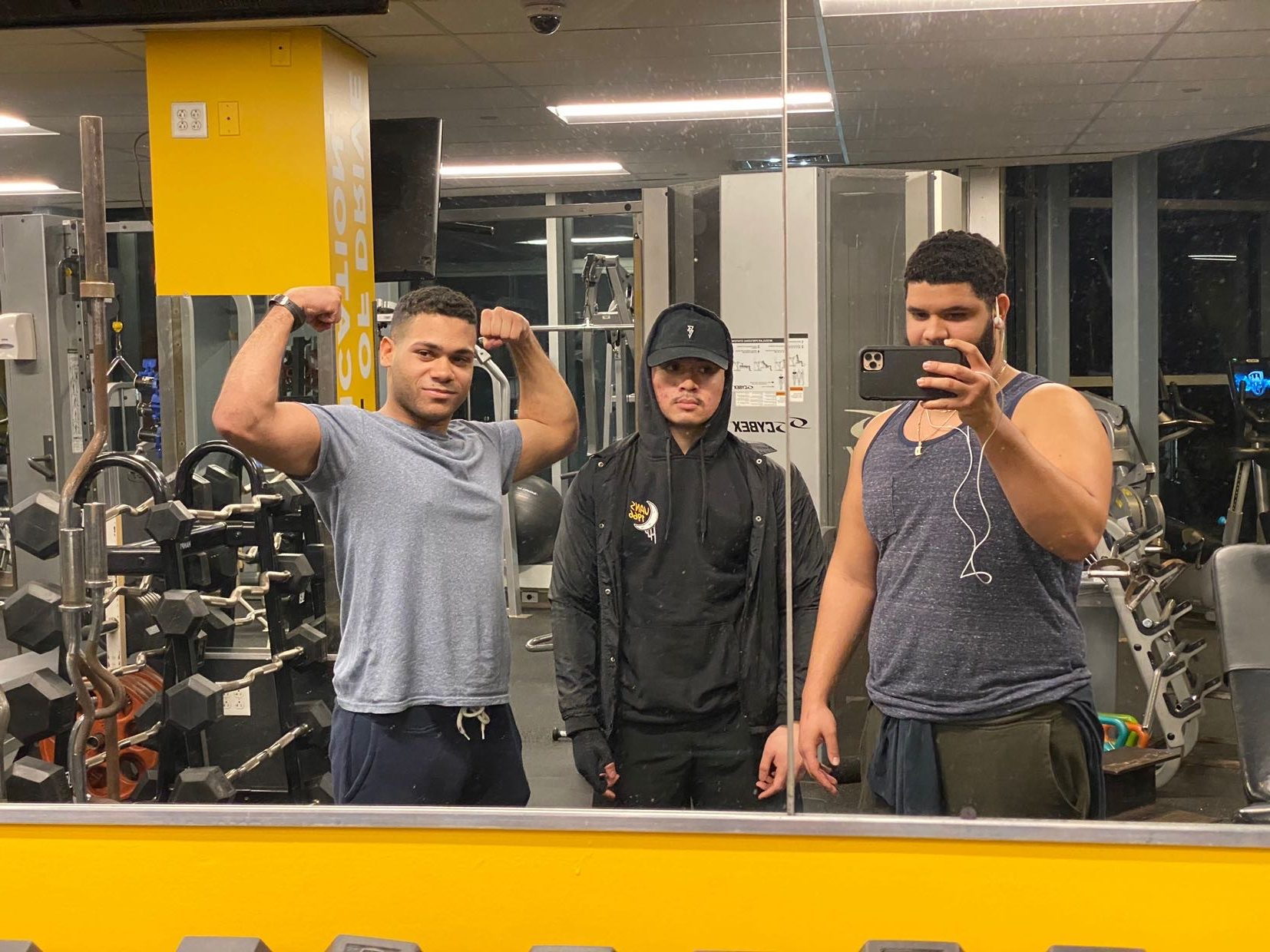 Carlos Pujols with friends in the Saint Rose fitness center