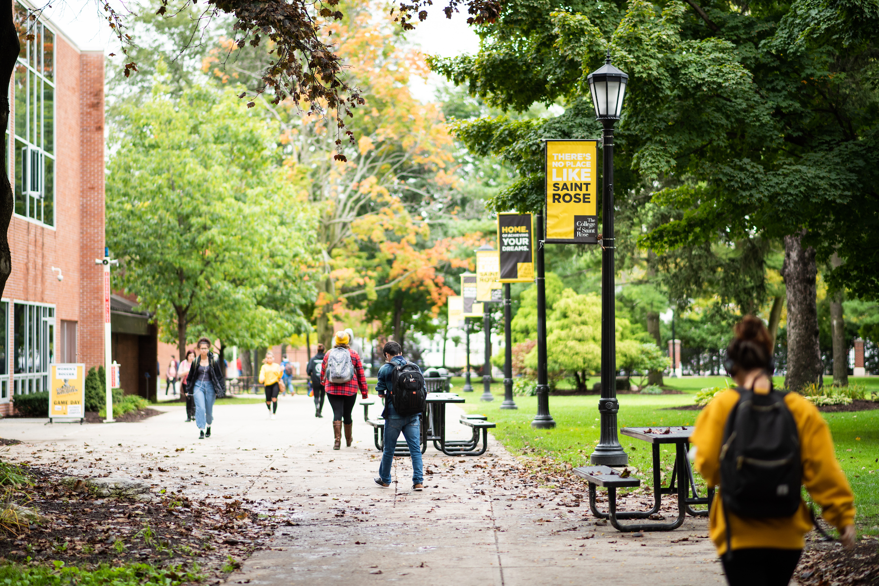 Students walking outside at College of Saint Rose campus during fall